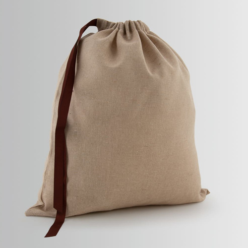 Cotton bag with drawstring closure and single attachment with ribbon